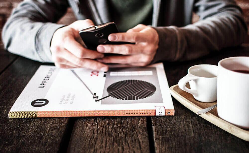 man-phone-coffee-table