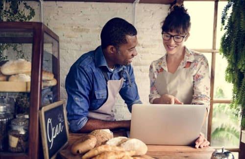 small-business-owner-baker-website-laptop